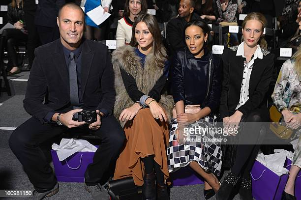 Photographer Nigel Barker Olivia Palermo Model Selita Ebanks and Model Poppy Delevingne attend the Noon By Noor Fall 2013 fashion show during...