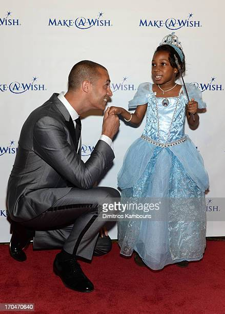 Photographer Nigel Barker poses with a Wish Kid at An Evening of Wishes MakeAWish Metro New York's 30th Anniversary Gala at Cipriani Wall Street on...
