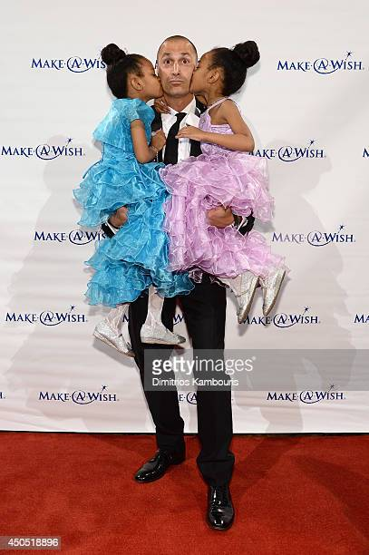 Photographer Nigel Barker poses with Wish Kids Shannon and Madison at the MakeAWish Metro New York Annual Gala An Evening of Wishes at Cipriani Wall...