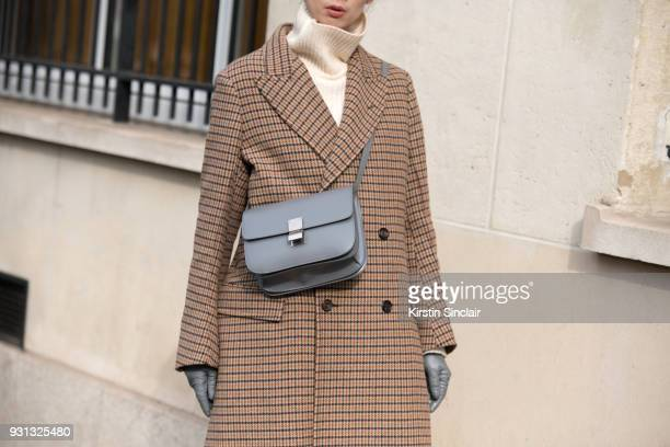 Photographer Norelle Weng wears a Joseph coat Céline bag day 2 of Paris Womens Fashion Week Spring/Summer 2018 on February 27 2018 in London England