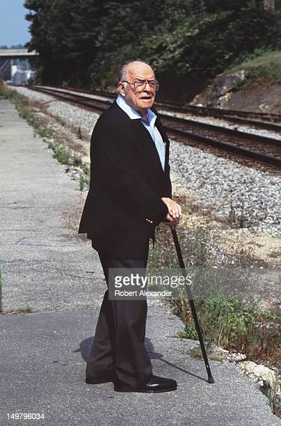 Photographer O Winston Link stands beside railroad tracks in Abingdon Virginia Link captured the waning days of steam railroading in America in the...