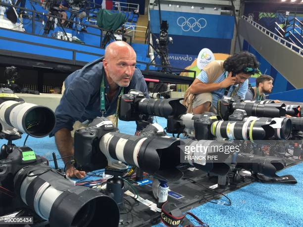 AFP Photographer Olivier Morin prepares his remote controlled cameras before the final of the 100m Men's final at Rio 2016 Olympic games on August 14...