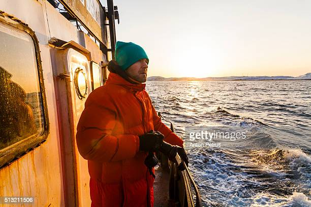 Photographer on board of the fishing boat