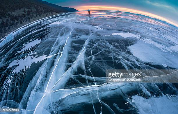 Photographer on ice in Lake Baikal