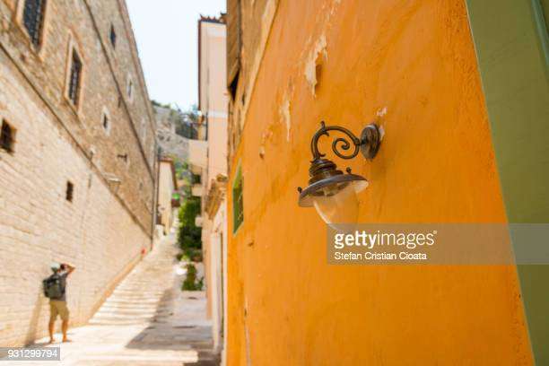 Photographer on narrow streets of Nafplion town, Greece