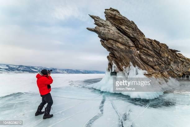 Photographer on the background of Ogoy Island, Lake Baikal, Russia