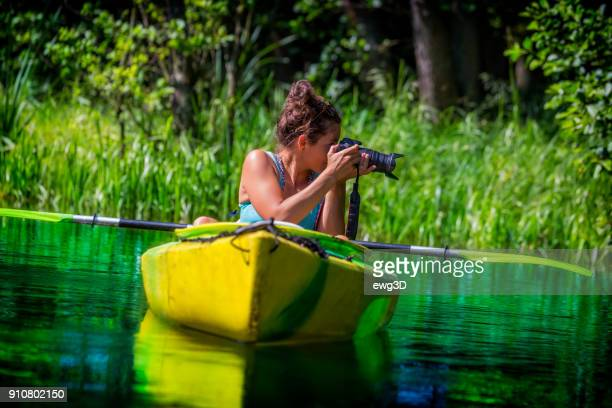 Photographer on vacation in a kayak