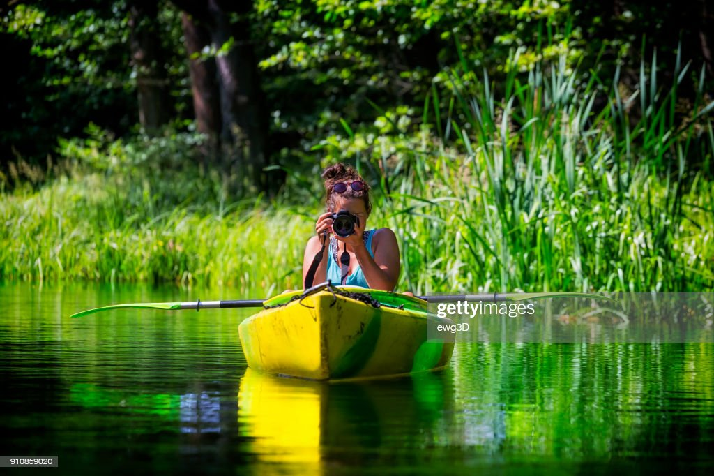 Photographer on vacation in a kayak : Stock Photo