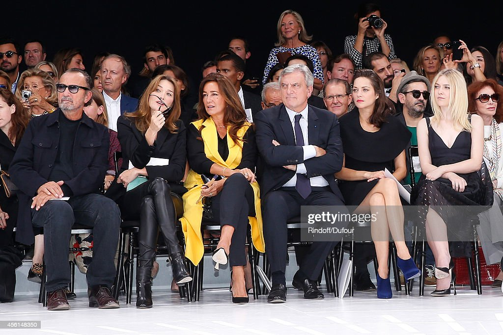 Photographer Paolo Reversi, Carla Bruni Sarkozy, Katia Toledano, her husband CEO Dior Sidney Toledano, actresses Marion Cotillard and Dakota Fanning attend the Christian Dior show as part of the Paris Fashion Week Womenswear Spring/Summer 2015 on September 26, 2014 in Paris, France.