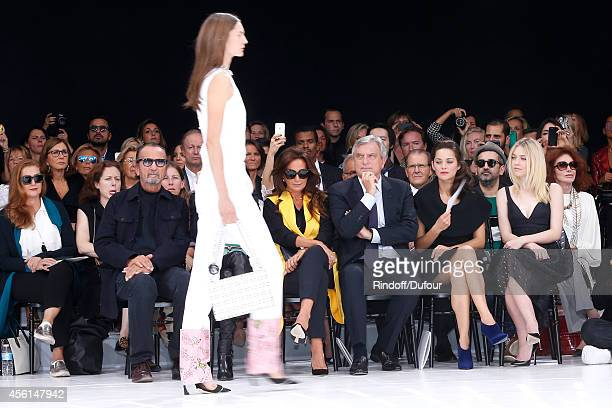 Photographer Paolo Reversi Katia Toledano her husband CEO Dior Sidney Toledano actresses Marion Cotillard and Dakota Fanning attend the Christian...