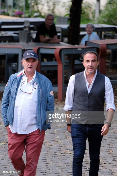 Photographer Pascal Rostain and Nikos Aliagas attend 'Les Amis de Yann ArthusBertrand se Vendent aux Encheres' Auction in Domaine de Longchamps on...