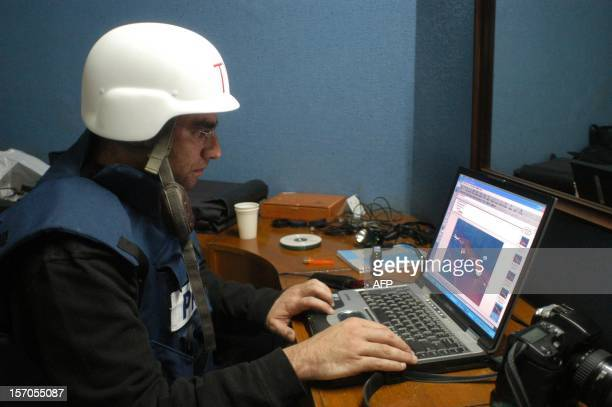 AFP photographer Patrick Baz edits pictures after a USled air raid from a room at the Palestine hotel overlooking Iraqi President Saddam Hussein's...