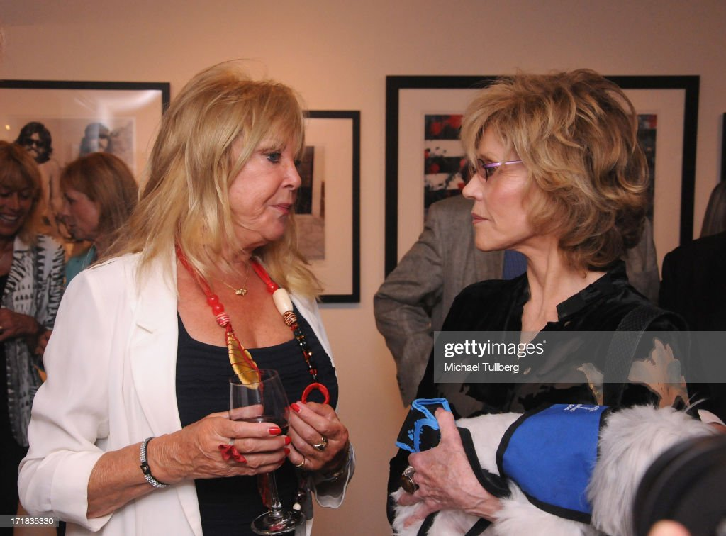 Photographer Pattie Boyd chats with actress Jane Fonda at an exhibition of Boyd's photographs entitled 'Pattie Boyd: Newly Discovered' at Morrison Hotel Gallery on June 28, 2013 in West Hollywood, California.