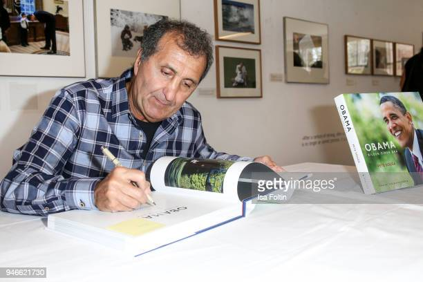 Photographer Pete Souza signs his book 'Obama An Intimate Portrait' at Kennedy Museum on April 15 2018 in Berlin Germany The exhibition shows 65...