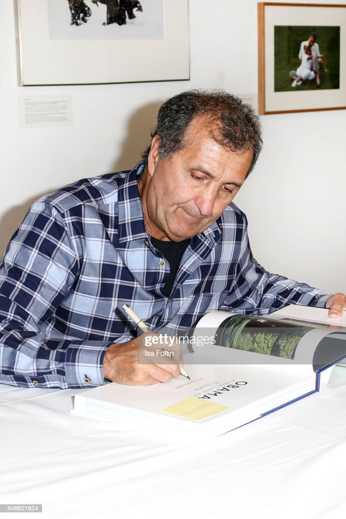 Photographer Pete Souza signs his book 'Obama: An Intimate Portrait' at Kennedy Museum on April 15, 2018 in Berlin, Germany. The exhibition shows 65 photographs taken from the oeuvre of Pete Souza, former Chief White House Photographer (2009-2017) and will be open until April 29, 2018.