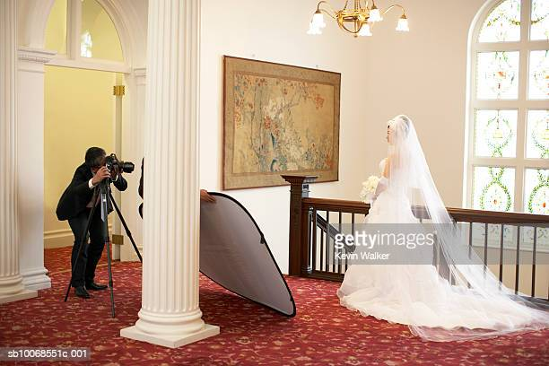 Photographer photographing bride