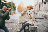photographer photographing classy mature woman city