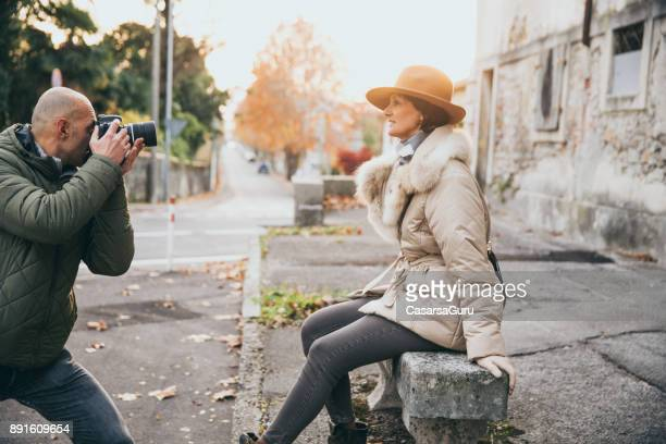 Photographer Photographing Classy Mature Woman on City Street