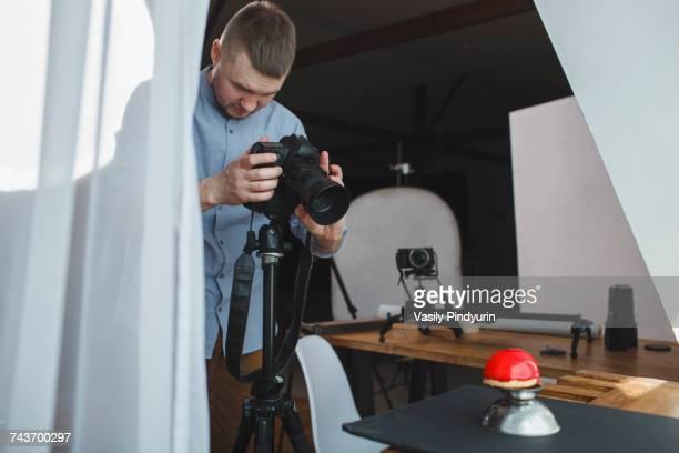 Photographer photographing food in studio