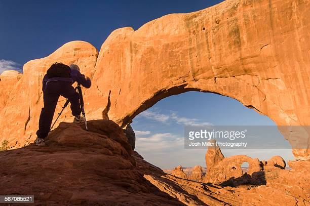 Photographer photographing Windows Arch, Arches National Park