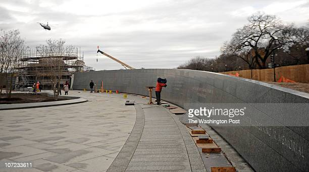 A photographer photographs quotes by Martin Luther King Jr which are engraved on a stone wall surrounding the Martin Luther King Jr National Memorial...