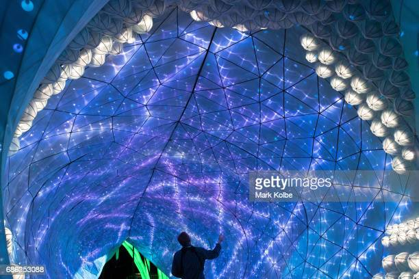 A photographer poses inside PJ the 20 metre walkthrough Port Jackson Shark installation one of the giant illuminated animal sculptures on display at...