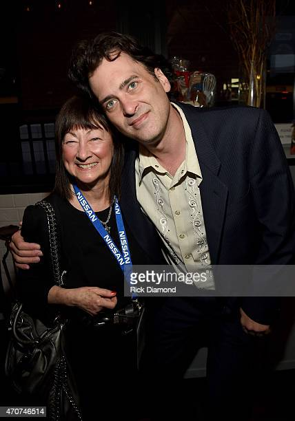 Photographer Raeanne Rubenstein and Peter Cooper of The Country Music Hall of Fame attend the world premiere of Annenberg Space for Photography's...