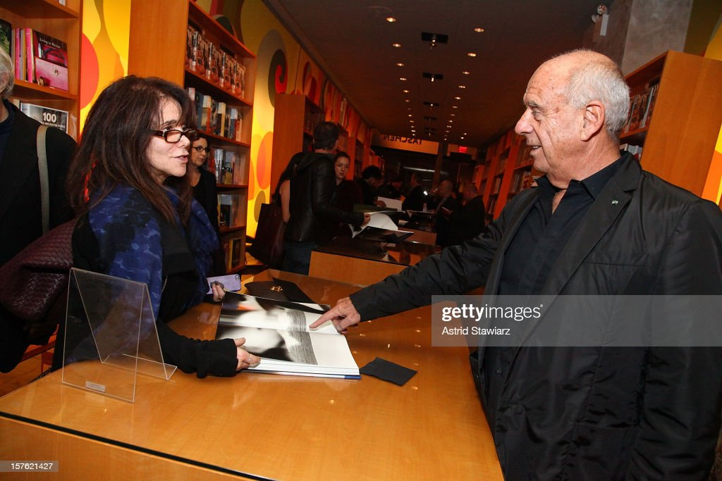 Photographer Ralph Gibson (right) signs copies of his new book 'Nude' at TASCHEN on December 4, 2012 in New York City.