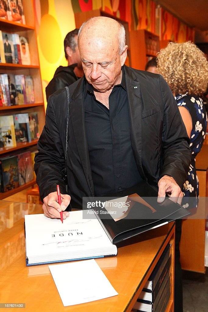 Photographer Ralph Gibson signs copies of his new book 'Nude' at TASCHEN on December 4, 2012 in New York City.