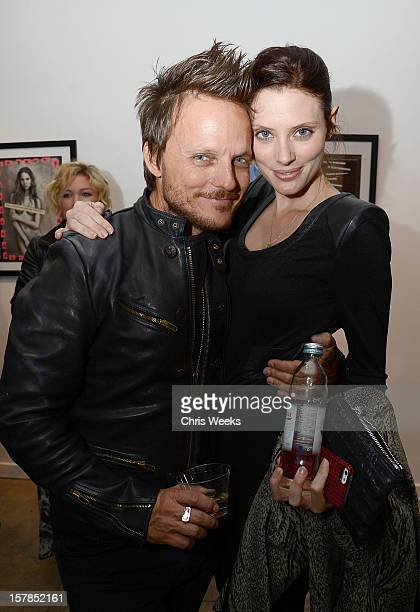 Photographer Randall Slavin and actress April Bowlby attend the opening of Wetdreams at Gallery Brown on December 6 2012 in Los Angeles California