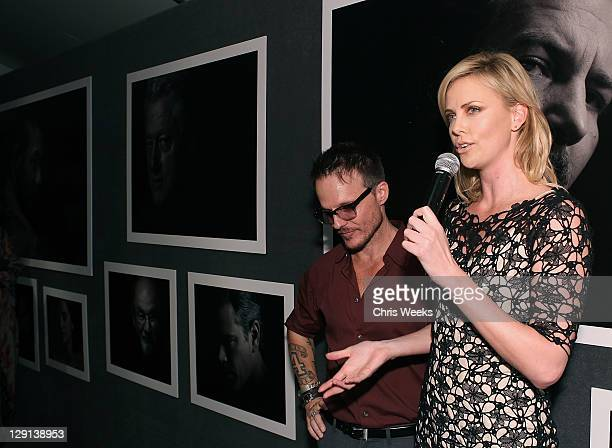 """Photographer Randall Slavin and actress Charlize Theron attend Charlize Theron Africa Outreach Projects premiere of Randall Slavin's """"Reach: 24..."""