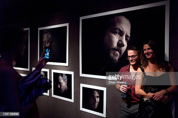 """Photographer Randall Slavin and guest attend Charlize Theron Africa Outreach Projects premiere of Randall Slavin's """"Reach: 24 Portraits"""" at Annenberg..."""