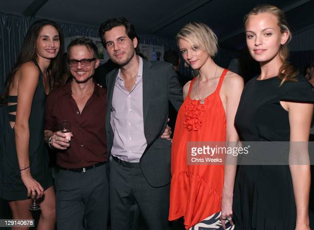 """Photographer Randall Slavin and guests attend Charlize Theron Africa Outreach Projects premiere of Randall Slavin's """"Reach: 24 Portraits"""" at..."""