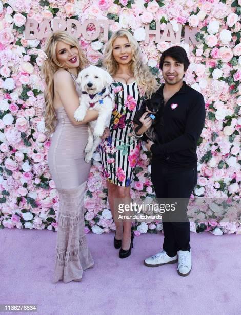 Photographer Raquel Rischard celebrity pilates instructor Carrie Minter and Vanderpump Dogs' John Blizzard attend the launch of Bardot Hair Line at...