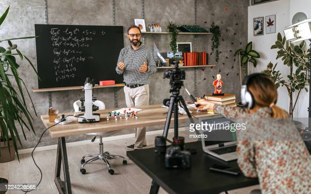 photographer recording educational video of professor for vlog on camera - instructions stock pictures, royalty-free photos & images
