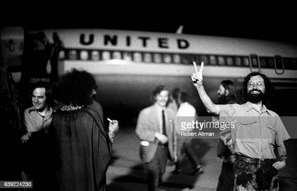 Photographer Robert Altman with attendee waits to board the United plane before the Alternative Media Conference at Goddard College in June 1720 1970...