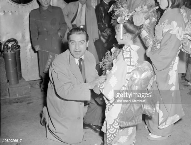 Photographer Robert Capa is seen on arrival at Haneda Airport on April 13, 1954 in Tokyo, Japan.