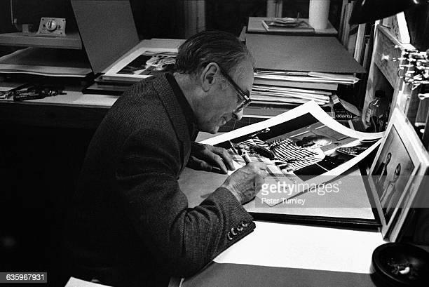 Photographer Robert Doisneau retouches a photograph of Pablo Picasso