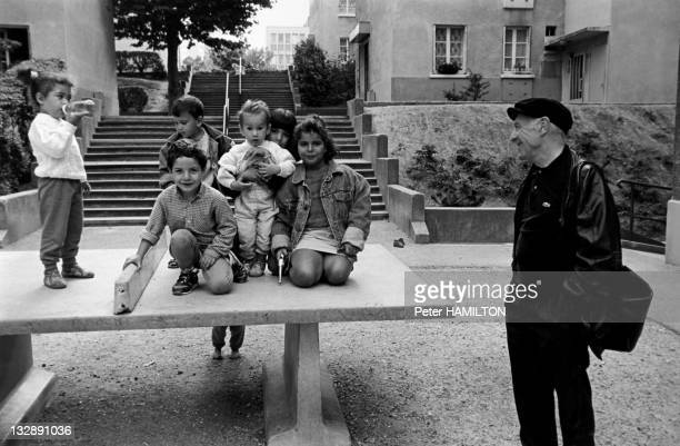 Photographer Robert Doisneau with children playing in a park during October 1992 in Montrouge Hauts de Seine France