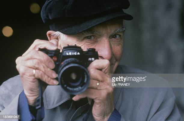 Photographer Robert Doisneau with his Leica camera during 1992 in France