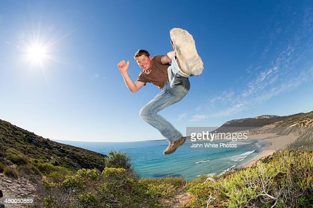 Photographer Robert Lang jumping in the air.