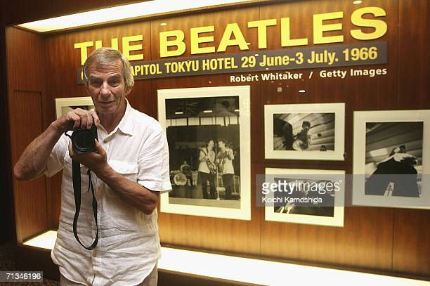 Photographer Robert Whitaker poses in front of his photographic exhibition during the events to mark the 40th anniversary of the Beatles' 1966 visit...