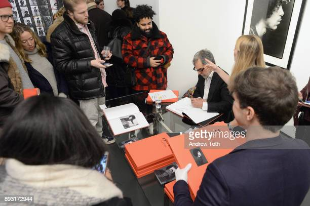 Photographer Robert Whitman signs books at Robert Whitman Presents Prince 'Pre Fame' Private Viewing Event Exclusively On Vero on December 14 2017 in...