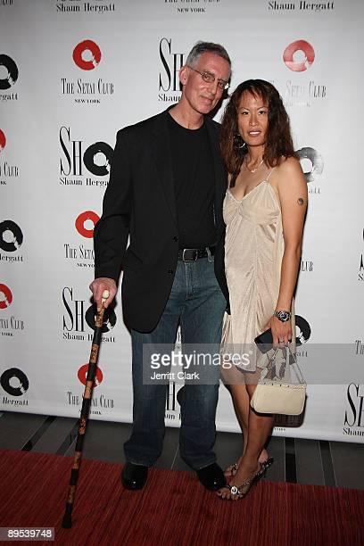 Photographer Robert Zuckerman and Evelyn Liu attend An Evening with Robert Zuckerman at The Setai Club July 1 2009 in New York City