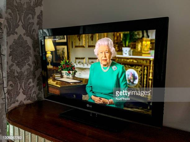 Photographer Robin Pope watches Queen Elizabeth II addresses the nation in a special broadcast to the United Kingdom and the Commonwealth in relation...