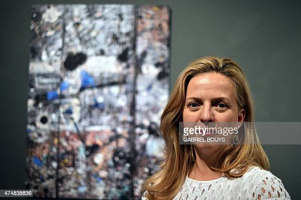 US photographer Robyn Lea poses in front of a photography showing Jackson Pollock's studio floor during the opening of the exhibition 'Dinner with...
