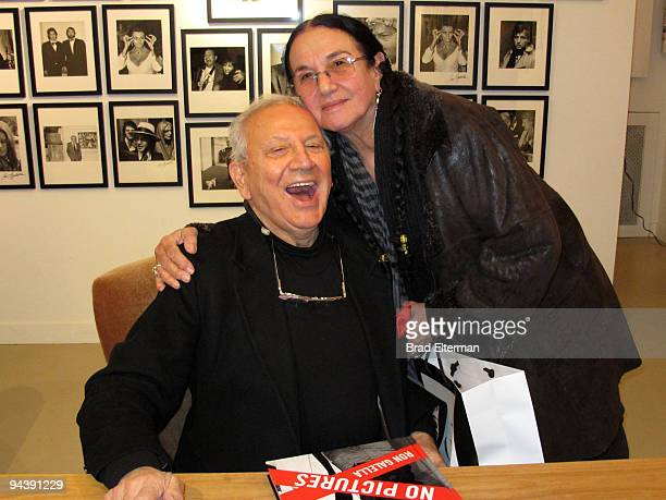 Photographer Ron Galella poses with Mary Ellen Mark as he promotes copies of his new book titled Viva L'Italia at the Clic Gallery on December 12...