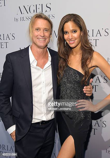 Photographer Russell James and model Keir Alexa attend Russell James' Angels book launch hosted by Victoria's Secret on September 10 2014 in New York...