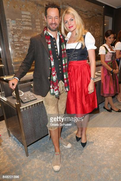 Photographer Sebastian Copeland and his wife Carolin Copeland during the 'Fruehstueck bei Tiffany' at Tiffany Store ahead of the Oktoberfest on...