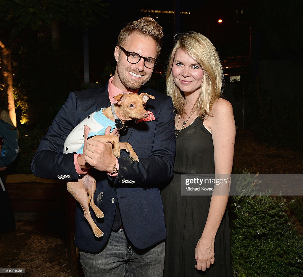 Photographer Seth Casteel (L), Courtney Dasher, and dog Tuna (aka TunaMeltsMyHeart) enjoy the 'More Than a Cone' art auction and campaign launch benefiting Best Friends Animal Society in Los Angeles where renowned artists re-imagined the 'cone of shame' to raise awareness for animals in need at LA Plaza de Cultura y Artes on June 21, 2014 in Los Angeles, California.